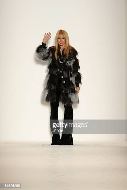 Designer Rachel Zoe waves to the audience at the Rachel Zoe Fall 2013 fashion show during MercedesBenz Fashion Week in The Studio at Lincoln Center...