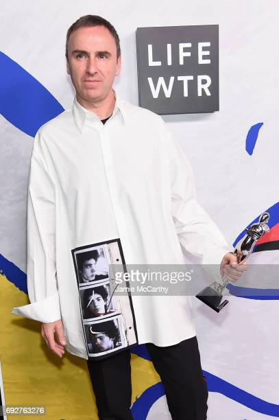 Designer Raf Simons for Calvin Klein poses with Womenswear Designer of the Year award on the Winners Walk during 2017 CFDA Fashion Awards at...