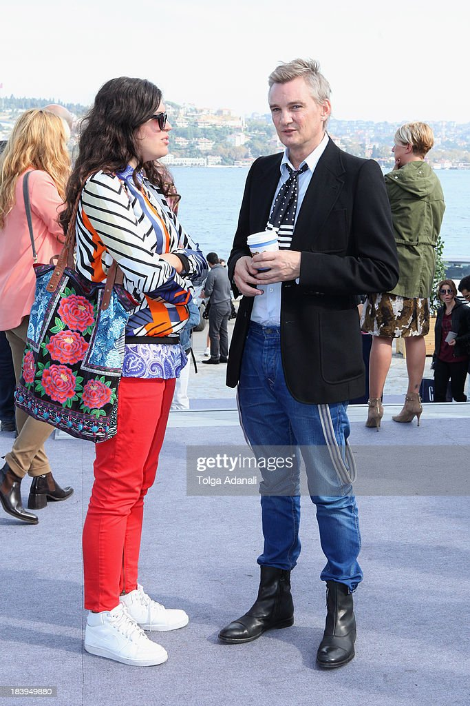 Designer Raf Stesmans (R) wears Scotch and Soda jeans and Zara shoes during Mercedes-Benz Fashion Week Istanbul s/s 2014 presented by American Express on October 10, 2013 in Istanbul, Turkey.