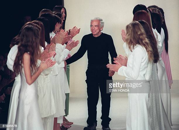 Designer Ralph Lauren receives applause from models after his fashion show 04 November in New York. The show is part of the Fashion Week Spring 1999...