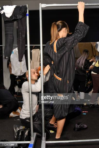 Designer Raul Lopez prepares a model backstage for Luar fashion show during New York Fashion Week The Shows at Gallery II at Spring Studios on...
