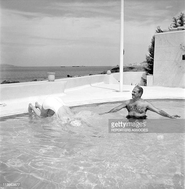 Designer Raymond Loewy on holiday in Southern France with wife Viola In Saint Tropez France In 1960With young wife Viola in their pool