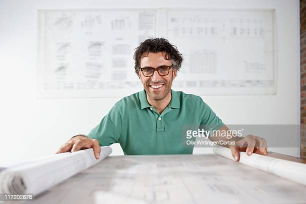 designer reading blueprint - design occupation stock pictures, royalty-free photos & images