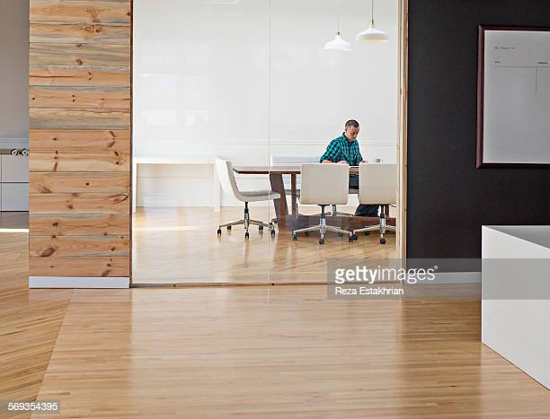Designer reads paperwork