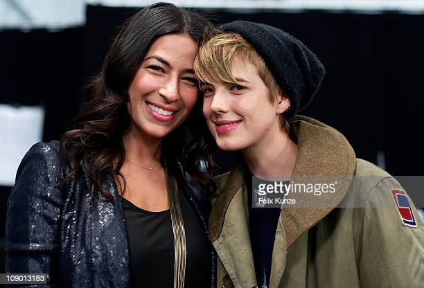 Designer Rebecca Minkoff poses with Model and Actress Agyness Deyn backstage at the Rebecca Minkoff Fall 2011 fashion show during MercedesBenz...
