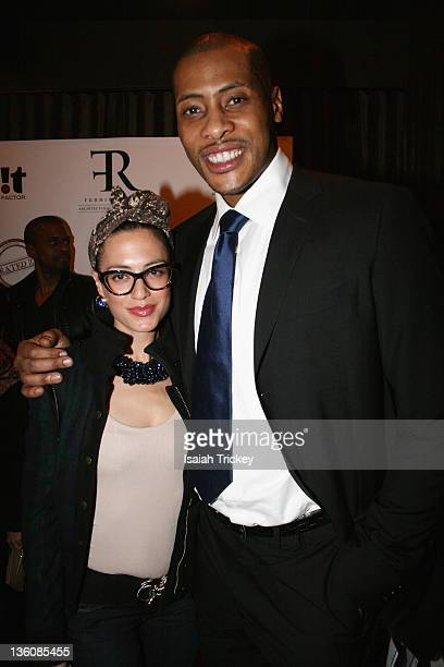 Designer Rebecca Price and NBA player Jamaal Magloire attend the Kardinal Offishall 13th Annual Christmas Party at Crown Lounge on December 22 2011...