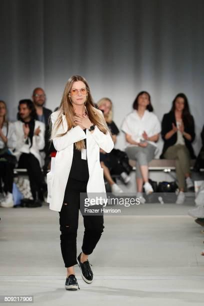 Designer Rebekka Ruetz acknowledges the applause of the audience at the Rebekka Ruetz show during the MercedesBenz Fashion Week Berlin Spring/Summer...