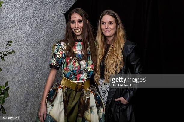 Designer Rebekka Ruetz and a model pose for a picture during the 'Kulinarik Kunst Festival' on August 20 2016 in St Anton am Arlberg Austria