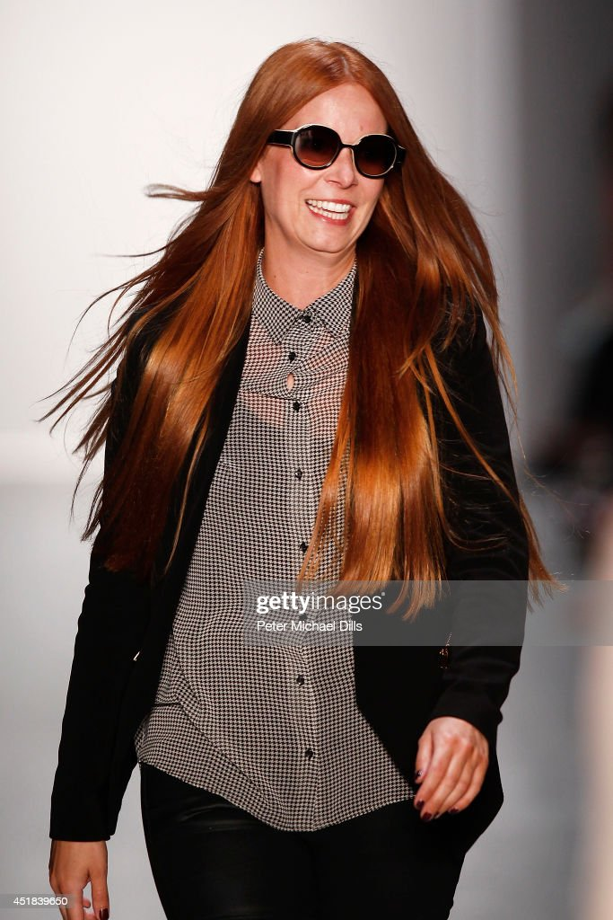 Designer Rebekka Ruetz appears at the end of the runway after the Rebekka Ruetz show during the Mercedes-Benz Fashion Week Spring/Summer 2015 at Erika Hess Eisstadion on July 8, 2014 in Berlin, Germany.