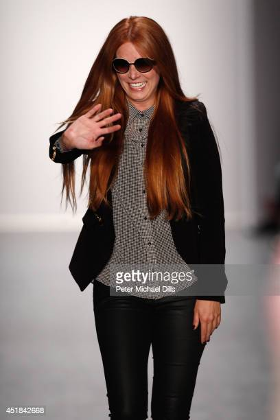 Designer Rebekka Ruetz appears at the end of the runway after the Rebekka Ruetz show during the MercedesBenz Fashion Week Spring/Summer 2015 at Erika...
