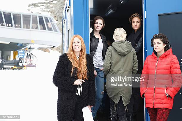 Designer Rebekka Ruetz gestures while Marie Nasemann and Alena Gerber look on prior to the Rebekka Ruetz Fashion Show at Top Mountain Star on April...