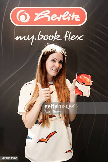 Designer Rebekka Ruetz poses at the Herlitz booth with the notebook she designed during the MercedesBenz Fashion Week Berlin Spring/Summer 2016 at...