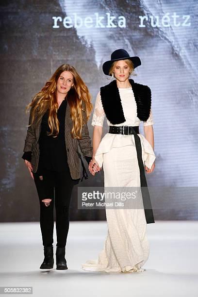 Designer Rebekka Ruetz walks with Larissa Marolt following her show during the MercedesBenz Fashion Week Berlin Autumn/Winter 2016 at Brandenburg...