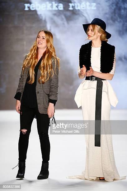 Designer Rebekka Ruetz walks with Larissa Marolt following her show during the Mercedes-Benz Fashion Week Berlin Autumn/Winter 2016 at Brandenburg...