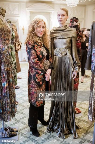 Designer Reem Acra and a model pose during the Reem Acra presentation as part of the Paris Fashion Week Womenswear Fall/Winter 2017/2018 on March 5...