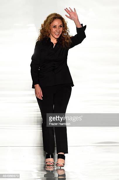Designer Reem Acra appears on the runway at the Reem Acra fashion show during MercedesBenz Fashion Week Spring 2015 at The Salon at Lincoln Center on...