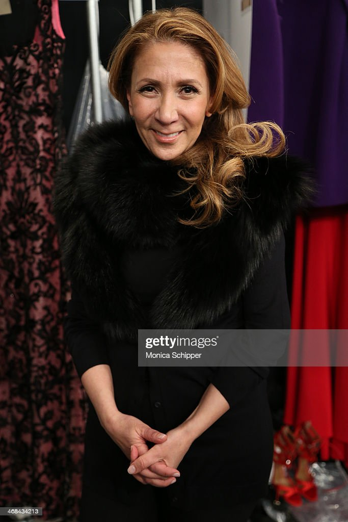 Designer Reem Acra prepares backstage at the Reem Acra fashion show during Mercedes-Benz Fashion Week Fall 2014 at The Salon at Lincoln Center on February 10, 2014 in New York City.