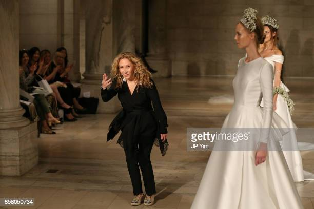 Designer Reem Acra walks the runway at the Reem Acra FW 2018 Bridal Show at the New York Public Library on October 5 2017 in New York City