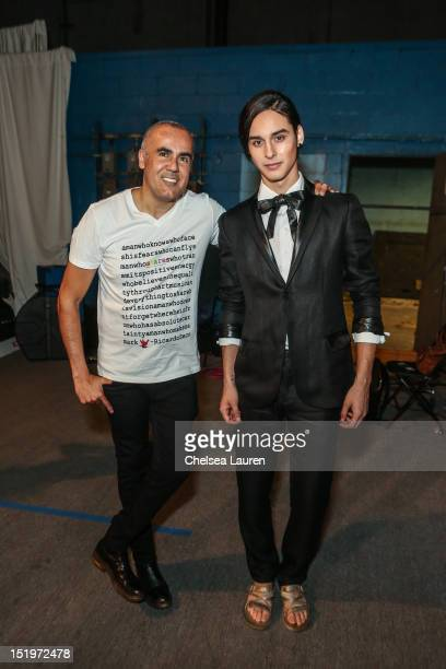 Designer Ricardo Seco poses with a model backstage at the Ricardo Seco spring 2013 fashion show during MercedesBenz Fashion Week at Pier 57 on...
