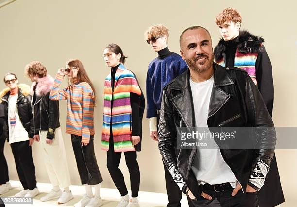 Designer Ricardo Seco poses with models at the Ricardo Seco presentation during New York Fashion Week Men's Fall/Winter 2016 at Skylight at Clarkson...