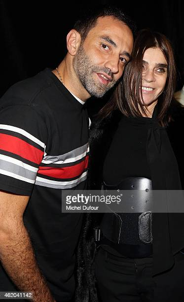 Designer Ricardo Tisci and Carine Roitfeld pose backstage after the Givenchy Menswear Fall/Winter 2015-2016 show as part of Paris Fashion Week on...
