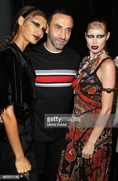 Designer Ricardo Tisci and models pose backstage after the Givenchy Menswear Fall/Winter 2015-2016 show as part of Paris Fashion Week on January 23,...