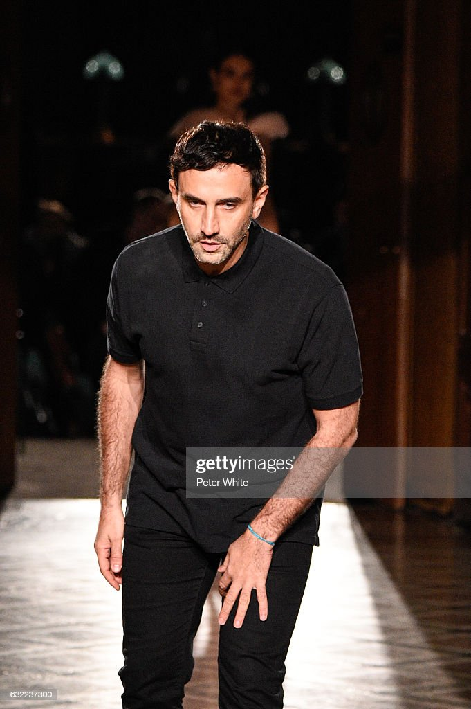 Designer Riccardo Tisci acknowledges the applause of the audience after the Givenchy Menswear Fall/Winter 2017-2018 show as part of Paris Fashion Week on January 20, 2017 in Paris, France.