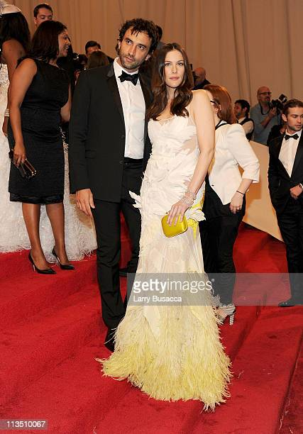 Designer Riccardo Tisci and Liv Tyler attend the 'Alexander McQueen Savage Beauty' Costume Institute Gala at The Metropolitan Museum of Art on May 2...
