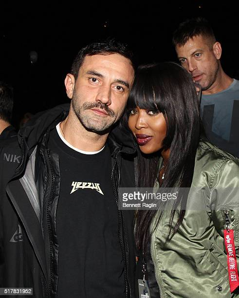 Designer Riccardo Tisci and Naomi Campbell attend the D'USSE VIP Riser At Rihanna ANTI World Tour at Barclays Center on March 27 2016 in New York City