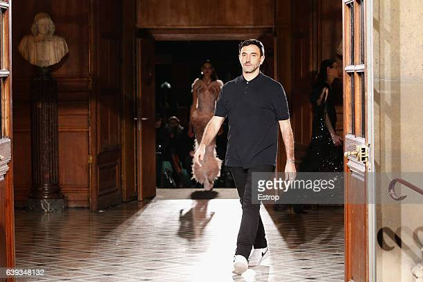 Designer Riccardo Tisci walks the runway during the Givenchy designed by Riccardo Tisci Menswear Fall/Winter 20172018 show as part of Paris Fashion...