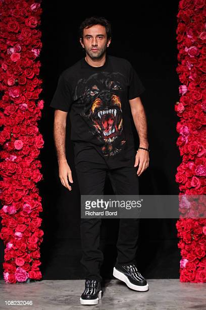 Designer Riccardo Tisci walks the runway during the Givenchy show as part of Paris Menswear Fashion Week Fall/Winter 2011-2012 on January 21, 2011 in...