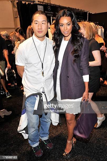 Designer Richard Chai and Brandi Garnett pose backstage at the Richard Chai Spring 2014 fashion show during MercedesBenz Fashion Week at The Stage at...