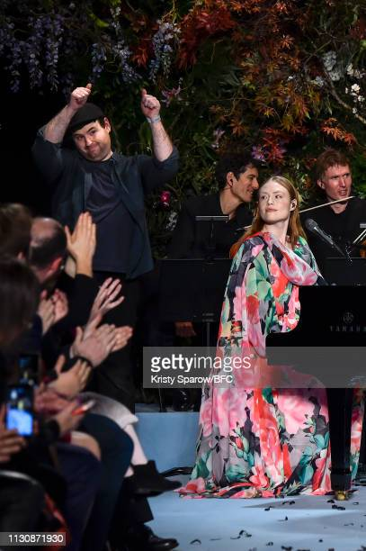Designer Richard Quinn acknowledges the audience during the Richard Quinn show as part of London Fashion Week February 2019 at Ambika P3 on February...
