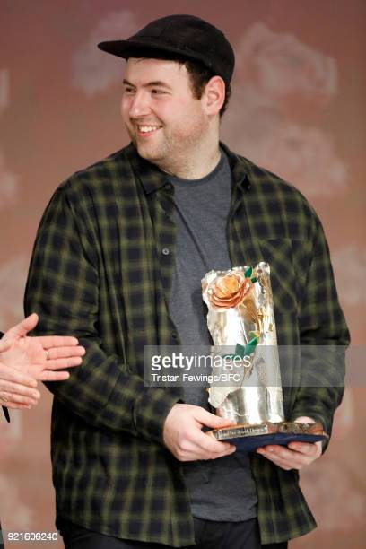 Designer Richard Quinn is presented with the inaugural Queen Elizabeth II award for British Design during London Fashion Week February 2018 on...