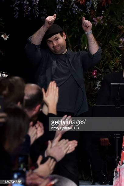 Designer Richard Quinn walks the runway at the Richard Quinn show during London Fashion Week February 2019 at Ambika P3 on February 19, 2019 in...
