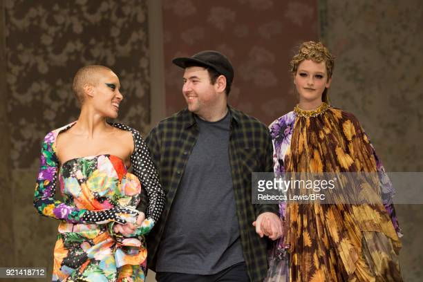 Designer Richard Quinn walks the show finale with model Adwoa Aboah of the Richard Quinn show during London Fashion Week February 2018 at BFC Show...