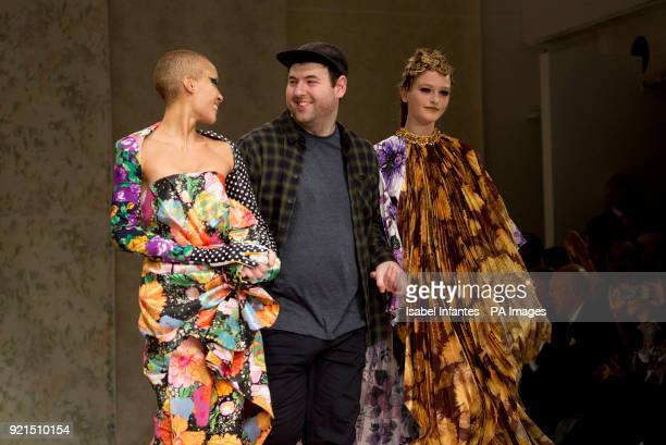 Designer Richard Quinn walks with model Adwoa Aboah, left, after presenting Autumn/Winter 2018 London Fashion Week show at BFC Showspace, London....