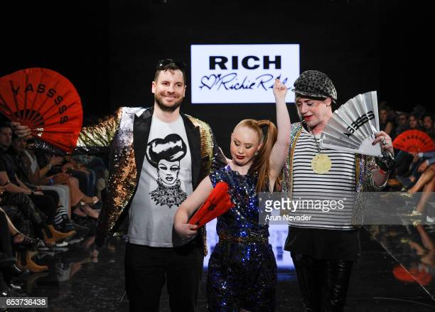 Designer Richie Rich and model/designer Madeline Stuart walk the runway with a model at Art Hearts Fashion LAFW Fall/Winter 2017 - Day 2 at The...