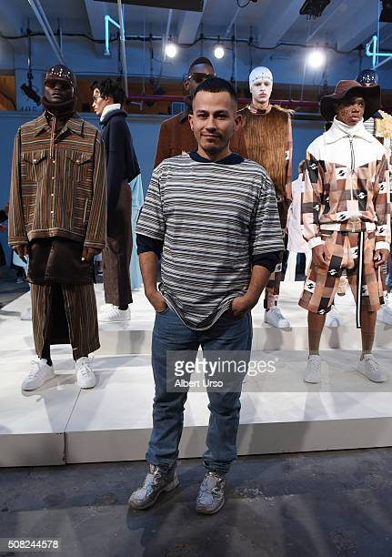 Designer Rio Uribe poses with models at the Gypsy Sport presentation during New York Fashion Week Men'sFall/Winter 2016 at Skylight at Clarkson Sq on...