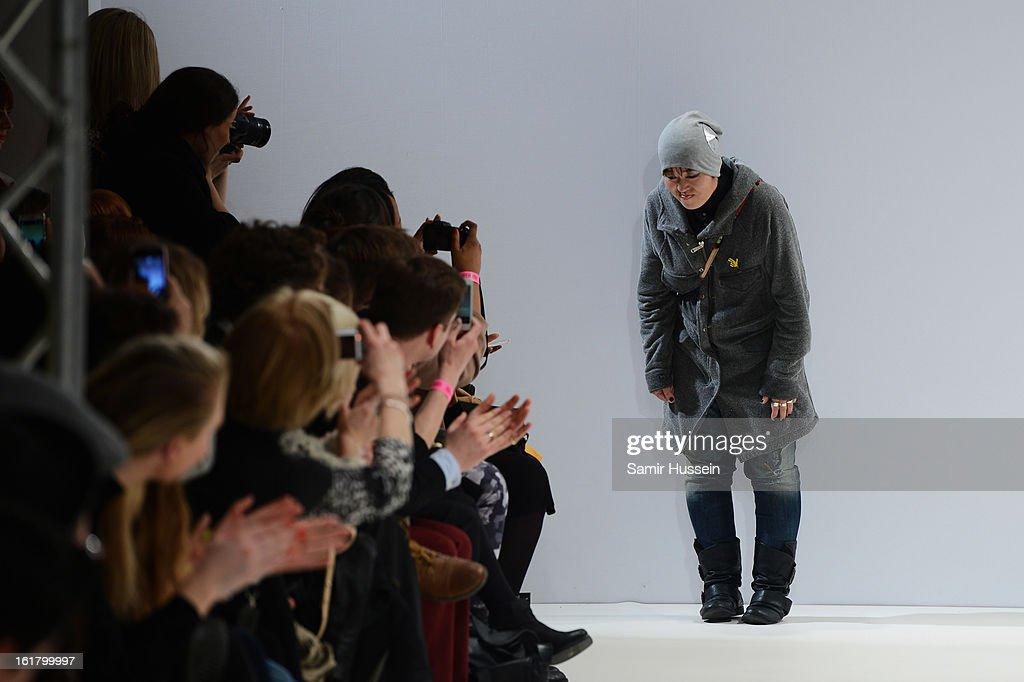Designer Rira Sugawara walks the runway at the Dans La Vie show during London Fashion Week Fall/Winter 2013/14 at Freemasons Hall on February 16, 2013 in London, England.
