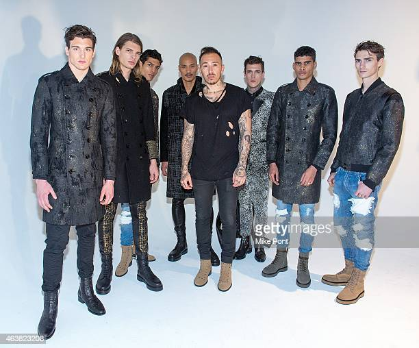 Designer Rob Garcia poses with models at the Rob Garcia Presentation during Mercedes-Benz Fashion Week Fall 2015 on February 18, 2015 in New York...