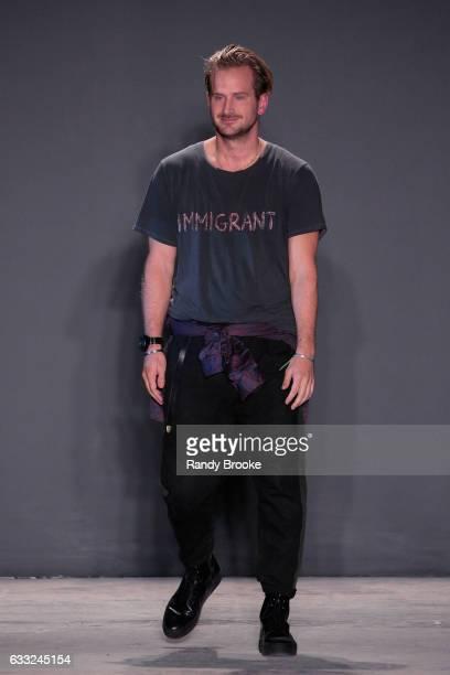 Designer Robert Geller greets the audience after his Robert Geller NYFW: Men's show at Skylight Clarkson North on January 31, 2017 in New York City.