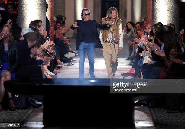 Designer Roberto Cavalli and his wife Eva acknoledge the applause of the public after the Roberto Cavalli show during Milan Fashion Week for Menswear...