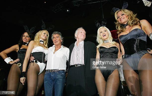 Designer Roberto Cavalli and Playboy founder and EditorinChief Hugh Hefner pose with Playboy Playmates Cara Zavaleta Irina Voronina Holly Madison and...
