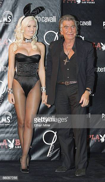 Designer Roberto Cavalli and Playboy Playmate Holly Madison wearing a Cavallidesigned Playboy Bunny costume take to the runway during a fashion show...