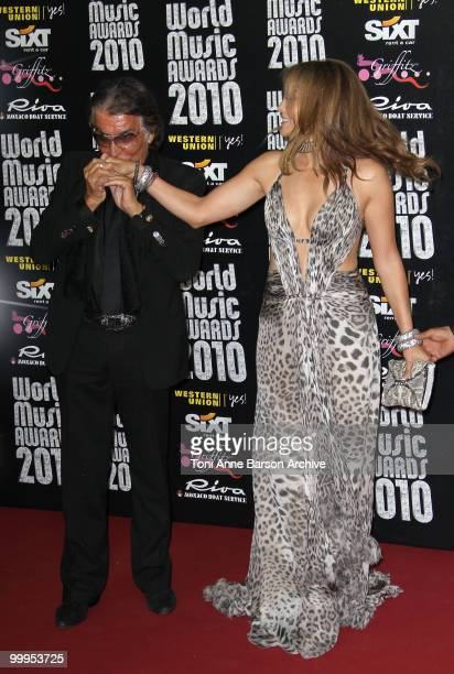 Designer Roberto Cavalli and singer/actress Jennifer Lopez attend the World Music Awards 2010 at the Sporting Club on May 18 2010 in Monte Carlo...