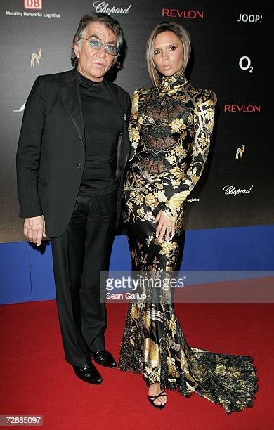 Designer Roberto Cavalli and Victoria Beckham attend the 58th annual Bambi Awards at the Mercedes-Benz Museum on November 30, 2006 in Stuttgart,...