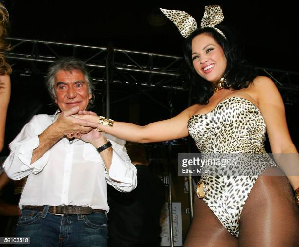 Designer Roberto Cavalli kisses the hand of Playboy Playmate of the Year 2005 Tiffany Fallon who models one of Cavalli's new Playboy Bunny costumes...