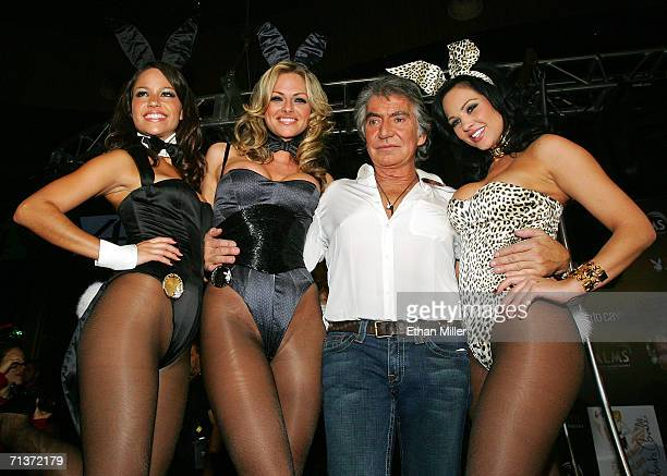 Designer Roberto Cavalli poses with Playboy Playmates Cara Zavaleta Stacy Sanches and Playboy Playmate of the Year 2005 Tiffany Fallon all modeling...