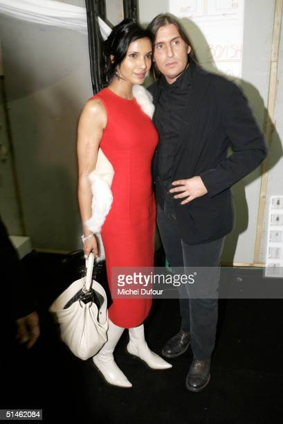Designer Roberto Menicheti and Padma Rushdie attend the Celine fashion show as part of Paris Fashion Week Spring/Summer 2005 on October 7 2004 in...